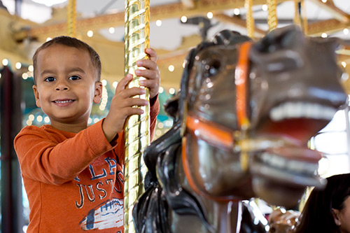 kid on carousel